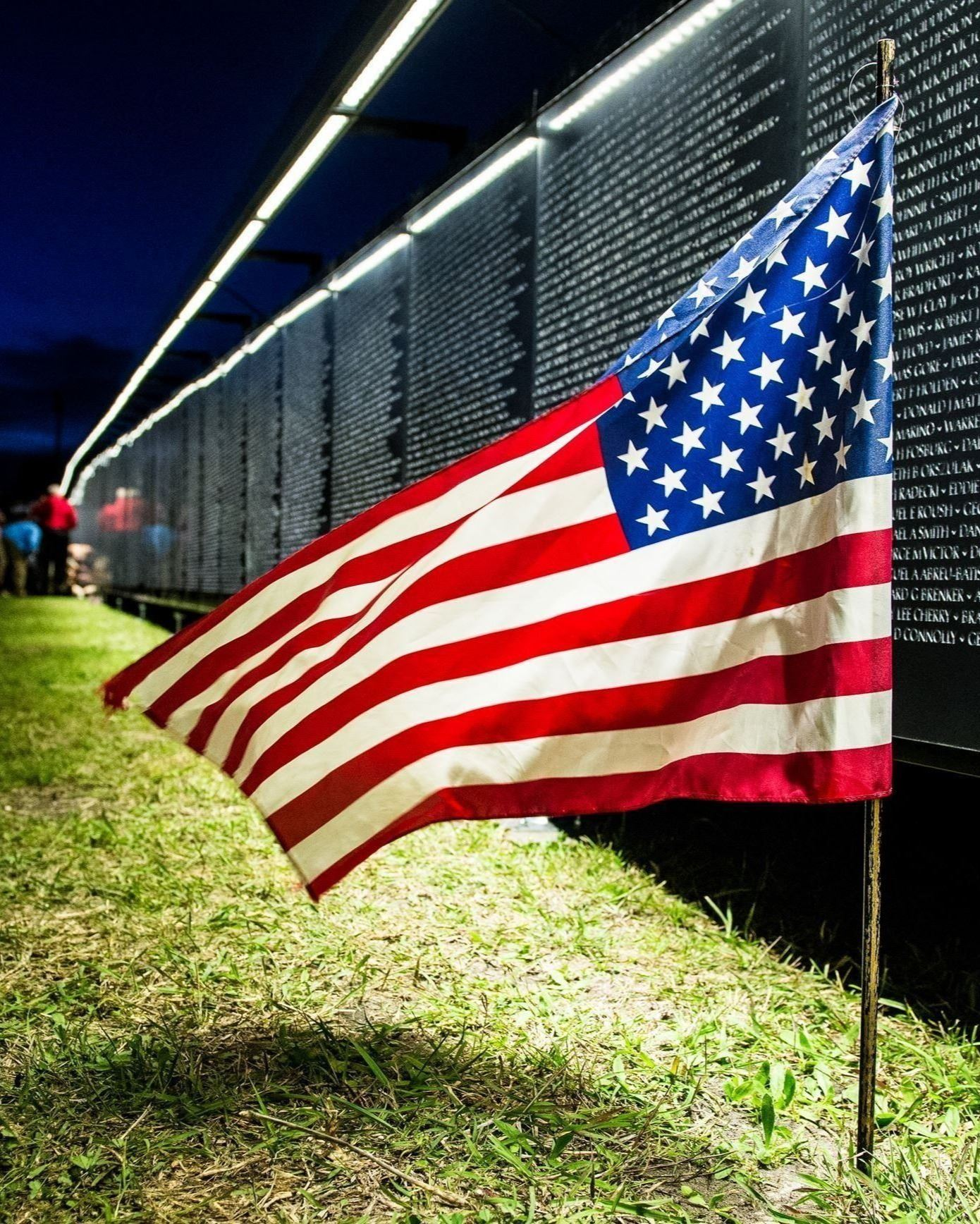 The wall that heals in Portland - american flag with illuminated wall at night