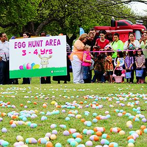 Children with Parents at Easter Egg Hunt